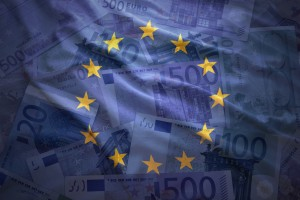 colorful waving european union flag on a euro money background